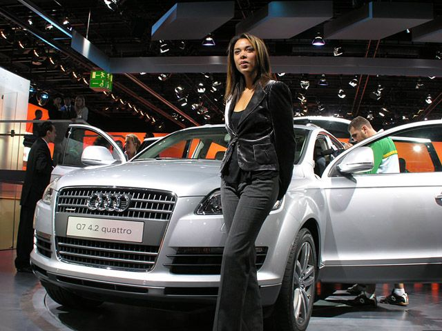 Audi Q7 and a hot girl presenter.