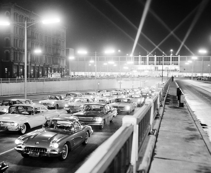 1960 Detroit Auto show, traffic in front Cobo Center
